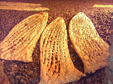 نان سنگک در تنور